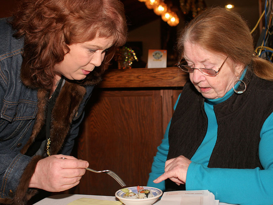 Kathy introduces Maureen to sushi